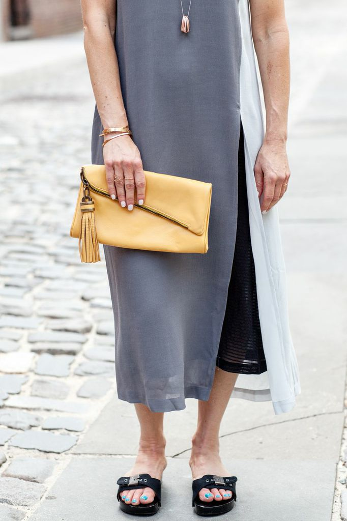 grey dress yellow clutch