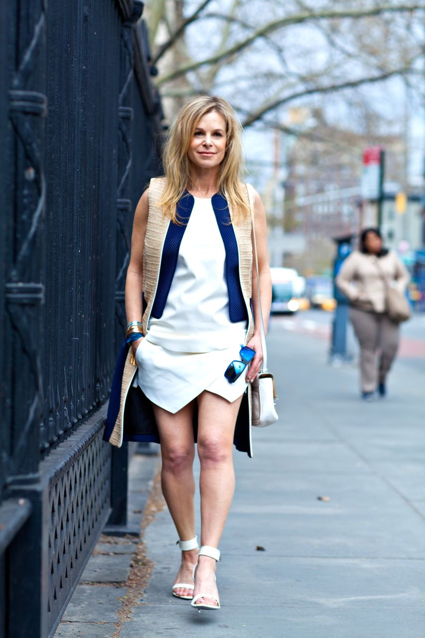 white skort and blue vest