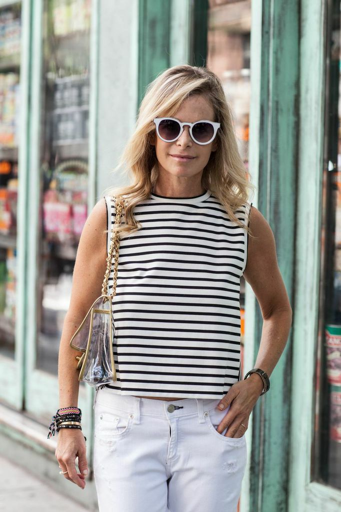 striped shirt and white jeans