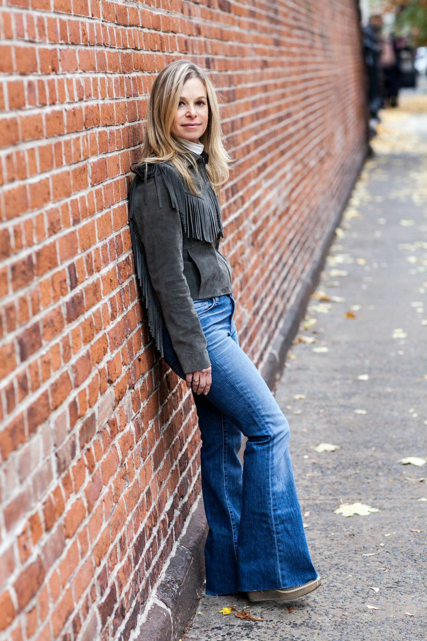 fringe jacket and bell bottom jeans